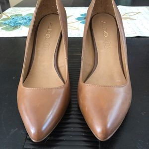 Brown Aldo pumps.